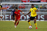 July 16th 2021; Orlando, Florida, USA; Jamaica forward Cory Burke is challenged by Morgan Saint-Maximin of Jamaica during the Concacaf Gold Cup match between Guadeloupe and Jamaica on July 16, 2021 at Exploria Stadium in Orlando, Fl.