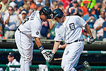 10 July 2010: Detroit Tigers first baseman Miguel Cabrera (24) celebrates with right fielder Magglio Ordonez (30) at home plate after Ordonez hit a home run during the Minnesota Twins at Detroit Tigers Major League Baseball game at Comerica Park, in Detroit, Michigan. The Tigers won 7-4.
