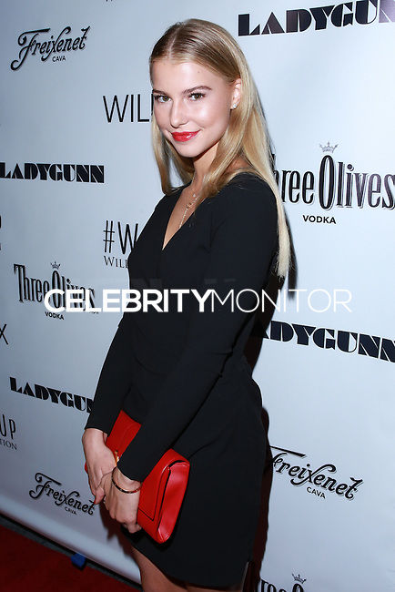 LOS ANGELES, CA, USA - DECEMBER 14:  Lexi Atkins arrives at the Wayke Up Fundraiser presented by Wildfox and Ladygunn Magazine hosted by Nikki Reed held at the Sofitel Hotel on December 14, 2014 in Los Angeles, California, United States. (Photo by David Acosta/Celebrity Monitor)