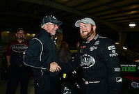 Sept. 16, 2012; Concord, NC, USA: NHRA team owner Alan Johnson (left) congratulates top fuel dragster driver Shawn Langdon celebrates after winning the O'Reilly Auto Parts Nationals at zMax Dragway. Mandatory Credit: Mark J. Rebilas-