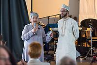 Feier zum einjaehrigen Bestehen der liberalen Ibn Rushd-Goethe Moschee in Berlin-Moabit.<br /> Die Ibn-Rushd-Goethe-Moschee ist eine liberale Moschee in Berlin. Sie wurde am 16. Juni 2017 eroeffnet. Ihre Gruendung geht massgeblich auf die Rechtsanwaeltin und Frauenrechtlerin Seyran Ates (links im Bild) zurueck.<br /> Die Benennung der Moschee erfolgte nach dem andalusischen Arzt und Philosophen Averroes (arab. Ibn Ruschd, 1126–1198), der im Mittelalter fuer seine Kommentare zum Werk von Aristoteles bekannt war, sowie nach dem deutschen Dichter Johann Wolfgang von Goethe (1749–1832) in Wuerdigung seiner Auseinandersetzung.<br /> In der Moschee wird ein liberaler Islam praktiziert. So sollen Frauen und Maenner gemeinsam beten, auch wird die Predigt von Frauen gesprochen. Homosexuelle Maenner und Frauen sind ausdruecklich willkommen. Die Moschee steht verschiedenen islamischen Konfessionen offen stehen, darunter Sunniten, Schiiten, Aleviten und Sufis.<br /> Rechts im Bild: Imam Dr. Ludovic Mohamed Zahed aus Frankreich. Er ist der einzige offen schwul lebende Imam Europas.<br /> 15.6.2018, Berlin<br /> Copyright: Christian-Ditsch.de<br /> [Inhaltsveraendernde Manipulation des Fotos nur nach ausdruecklicher Genehmigung des Fotografen. Vereinbarungen ueber Abtretung von Persoenlichkeitsrechten/Model Release der abgebildeten Person/Personen liegen nicht vor. NO MODEL RELEASE! Nur fuer Redaktionelle Zwecke. Don't publish without copyright Christian-Ditsch.de, Veroeffentlichung nur mit Fotografennennung, sowie gegen Honorar, MwSt. und Beleg. Konto: I N G - D i B a, IBAN DE58500105175400192269, BIC INGDDEFFXXX, Kontakt: post@christian-ditsch.de<br /> Bei der Bearbeitung der Dateiinformationen darf die Urheberkennzeichnung in den EXIF- und  IPTC-Daten nicht entfernt werden, diese sind in digitalen Medien nach §95c UrhG rechtlich geschuetzt. Der Urhebervermerk wird gemaess §13 UrhG verlangt.]