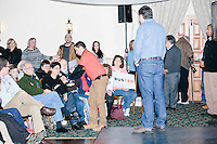 Texas senator and Republican presidential candidate Ted Cruz takes a question from the audience at a town hall at The Alpine Grove banquet center in Hollis, New Hampshire.