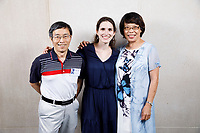 Contestant Klara Woskowiak of Poland poses with host family members Bruce Shei, left, and Hwa Mei Shei at a photo booth during the opening reception and dinner of the 11th USA International Harp Competition at Indiana University in Bloomington, Indiana on Wednesday, July 3, 2019. (Photo by James Brosher)