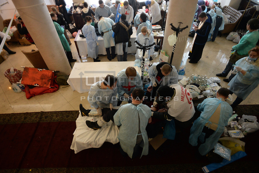 Makeshift clinic and morgue in the hotel Ukraine lobby. Death and injury toll raise every hour on the hour in Maidan square since the violent repression started. Kiev, Ukraine