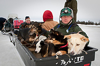 Volunteer veterinarian Roger Troutman helps take a portion of the 28 dropped dogs from the Nikolai checkpoint to the airstrip to be flown out on a Pennair Caravan back to Anchorage during Iditarod 2009