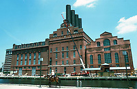 Baltimore:  #13.  Inner Harbor.  The Power Plant, 1895. Coal-fired electrical generation for trolley system.   Neo-Classical detailing,  Baldwin & Pennington.  NRHP 1987. (1997 update:  a 65 ft. neon guitar on the stack--Hard Rock Cafe. ) Photo '85.