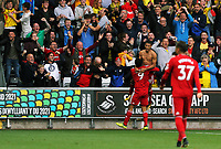 Richarlison of Watford takes his shirt off celebrating his goal with team mate Troy Deeney who lifts him up to the delight of away supporters during the Premier League match between Swansea City and Watford at The Liberty Stadium, Swansea, Wales, UK. Saturday 23 September 2017