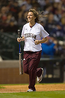 One of the Texas A&M Aggies bat girls returns to the dugout during game action versus the Rice Owls in the 2009 Houston College Classic at Minute Maid Park February 28, 2009 in Houston, TX.  The Owls defeated the Aggies 2-0. (Photo by Brian Westerholt / Four Seam Images)