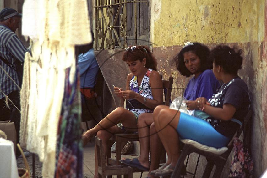 women at work along the street Trinidad in  Cuba
