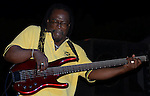 BassieDee, bass player for Interactive Roots Band, feels the music as he performs in Runaway Bay, Jamaica. (DOUG WOJCIK MEDIA)