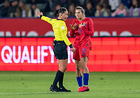 CARSON, CA - FEBRUARY 7: The referee talks to Tobin Heath #17 of the United States dribbles during a game between Mexico and USWNT at Dignity Health Sports Park on February 7, 2020 in Carson, California.