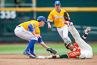 Miami Hurricanes outfielder Carl Chester (9) is tagged out by UC Santa Barbara Gauchos second baseman JJ Muno (9) in Game 5 of the NCAA College World Series on June 20, 2016 at TD Ameritrade Park in Omaha, Nebraska. UC Santa Barbara defeated Miami  5-3. (Andrew Woolley/Four Seam Images)
