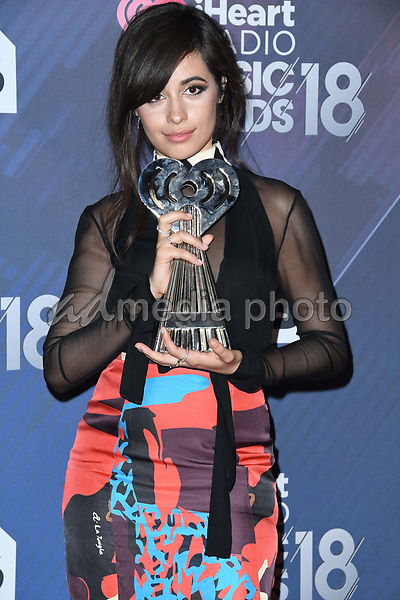 11 March 2018 - Inglewood, California - Camila Cabello. 2018 iHeart Radio Awards - Press Room held at The Forum. Photo Credit: Birdie Thompson/AdMedia