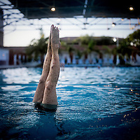 73 year old Margo Bouer does a handstand during an Aquadette practice at Laguna Woods, California. Margo suffers from severe MS, but says her nausea and shaking almost disappear when she is in the swimming pool. She has been with the Aquadettes for 16 years. The Aquadettes are a group of women ageing from their early 60s upwards who meet to practice synchronised swimming. Every year, they practice together, they make costumes together, they swim together, and at the end, they perform together.
