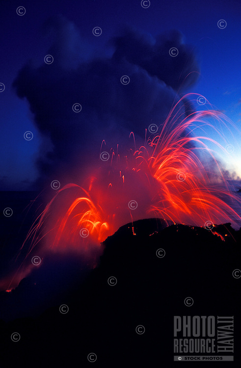 Fountaining lava explodes as it enters the sea off the Puna coast on the Big Island of Hawaii.