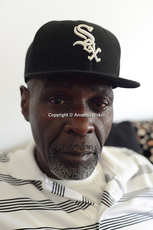 Stanley Wrice sits in the living room of the home he shares with his daughter and son-in-law in Calumet City, Illinois on November 4, 2015.  Wrice spent 31 years in jail for a crime he did not commit after a confession was extracted from him in 1982 by Chicago Police Area Two detectives using methods classified as torture.