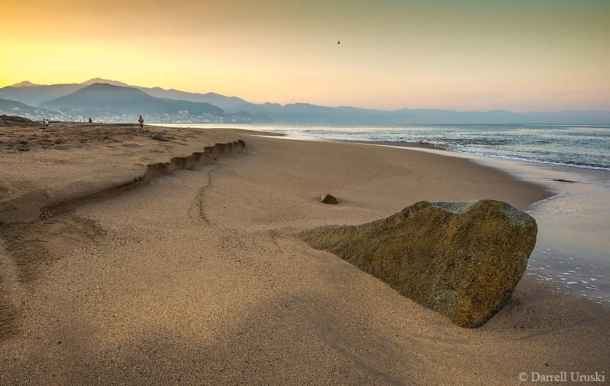Fine Art Landscape photograph. Scenic of a golden sunrise on the beaches of Puerto Vallarta, Mexico.