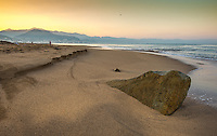 Fine Art Landscape photograph. Scenic of a golden sunrise on the beaches of Puerto Vallarta, Mexico.