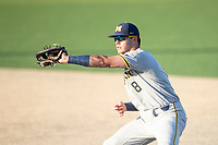 Michigan Wolverines first baseman Jimmy Obertop (8) makes a catch during the NCAA baseball tournament against the Connecticut Huskies on June 4, 2021 at Frank Eck Stadium in Notre Dame, Indiana. The Huskies defeated the Wolverines 6-1. (Andrew Woolley/Four Seam Images)