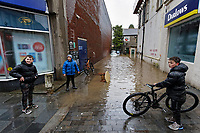 Pictured: Three young boys stand by a flooded lane in Pontypridd, Wales, UK. Sunday 16 February 2020<br /> Re: Storm Dennis has been affecting parts of Wales, UK.
