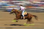 A woman barrel races at the Jordan Valley Big Loop Rodeo