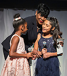 Houston ISD Trustee Wanda Adams hugs Law Elementary School students Jada Harrell and Tiffany Zepada during the State of the Schools luncheon at the Hilton of the Americas, February 15, 2017.