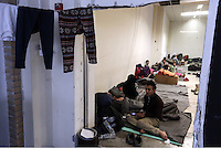 Pictured: Refugees resting inside the Helliniko camp Friday 26 February 2016<br /> Re: Refugees have been turning up at the Helliniko refugee camp in the outskirts of Athens, Greece.