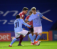 Lincoln City's Tom Hopper battles with Manchester City U21's Claudio Gomes, left, and Sammy Robinson<br /> <br /> Photographer Andrew Vaughan/CameraSport<br /> <br /> EFL Papa John's Trophy - Northern Section - Group E - Lincoln City v Manchester City U21 - Tuesday 17th November 2020 - LNER Stadium - Lincoln<br />  <br /> World Copyright © 2020 CameraSport. All rights reserved. 43 Linden Ave. Countesthorpe. Leicester. England. LE8 5PG - Tel: +44 (0) 116 277 4147 - admin@camerasport.com - www.camerasport.com