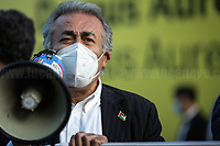 """Dr. Yousef Salman, President of the Palestinian Community of Rome and Lazio.<br /> <br /> Rome, Italy. 15th May, 2021. Today, thousands of Pro-Palestinian activists and members of the public gathered in Piazza dell'Esquilino to mark the 73rd Anniversary of """"Nakba"""" («The 1948 Palestinian exodus, also known as the Nakba literally """"disaster"""", """"catastrophe"""", or """"cataclysm"""", occurred when more than 700,000 Palestinian Arabs fled or were expelled from their homes, during the 1948 Palestine war […]», 1.); to show support and solidarity to the Palestinian People; to protest against the crisis between Palestinian people and the Israeli armed forces which began on the 6th of May 2021 with the decision of the Israeli Supreme Court to evict four Palestinian families from the East Jerusalem neighborhood of Sheikh Jarrah, part of the Palestinian Territories under international law. The protests quickly escalated in an asymmetric conflict between Israeli Air Forces airstrikes and Hamas' rockets fired from the Gaza Strip which killed at least 190 Palestinians, including 41 children, and 10 Israelis, including 2 children. The demonstration in Rome - organised by the Palestinian Community of Rome and Lazio (2.) - culminated with a peaceful march which ended outside the Colosseum, while Similar demonstrations were held in the major cities across the globe.<br /> <br /> Footnotes & Links:<br /> 1. (Source Wikipedia.org. ENG) https://en.wikipedia.org/wiki/1948_Palestinian_exodus<br /> 2. https://www.facebook.com/groups/sandoga/<br /> Other Organizations involved: http://www.assopacepalestina.org/ & http://bit.do/frfpo<br /> For Live Updates (Source, Aljazeera.com ENG): https://www.aljazeera.com/news/2021/5/16/more-deaths-gaza-israel-launches-most-intense-raids-yet"""