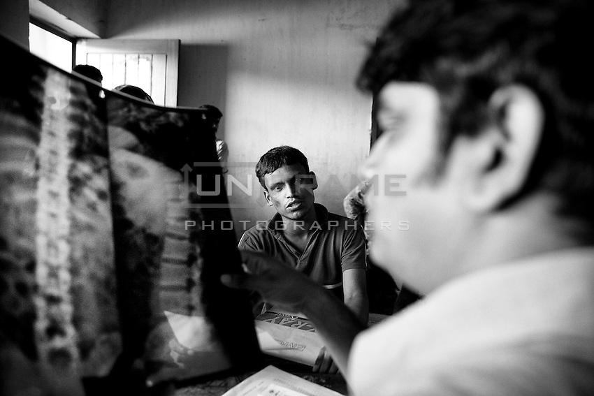 Victims of Rana plaza collapse gathered for free treatment at Adhar Chandra high school in Savar, near Dhaka, Bangladesh.