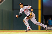 Baltimore Orioles third baseman Manny Machado #13 runs towards a ground ball during the Major League Baseball game against the Texas Rangers on August 21st, 2012 at the Rangers Ballpark in Arlington, Texas. The Orioles defeated the Rangers 5-3. (Andrew Woolley/Four Seam Images).