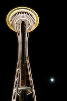 Nighttime scene of Seattle Space Needle towering above full moon, Seattle Center, Seattle, Washington, US