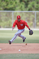 Washington Nationals Bryan Mejia (9) fields a ball during practice before a minor league Spring Training game against the St. Louis Cardinals on March 27, 2017 at the Roger Dean Stadium Complex in Jupiter, Florida.  (Mike Janes/Four Seam Images)