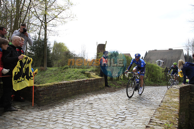 The breakaway group led by Anders Lund (DEN) Saxo Bank enter the Molenberg climb during the 96th edition of The Tour of Flanders 2012, running 256.9km from Bruges to Oudenaarde, Belgium. 1st April 2012. <br /> (Photo by Steven Franzoni/NEWSFILE).