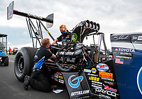 Jul 11, 2020; Clermont, Indiana, USA; Crew members for NHRA top fuel driver Tony Schumacher during qualifying for the E3 Spark Plugs Nationals at Lucas Oil Raceway. This is the first race back for NHRA since the start of the COVID-19 global pandemic. Mandatory Credit: Mark J. Rebilas-USA TODAY Sports