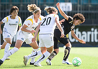24 May 2009: Eriko Arakawa of the FC Gold Pride dribbles the ball away from Los Angeles Sol defenders during the game at Buck Shaw Stadium in Santa Clara, California.  Los Angeles Sol defeated FC Gold Pride, 2-0.