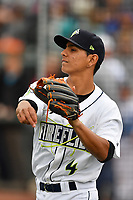 Shortstop Andres Jimenez (4) of the Columbia Fireflies warms up before a game against the Lakewood BlueClaws on Friday, May 5, 2017, at Spirit Communications Park in Columbia, South Carolina. Lakewood won, 12-2. (Tom Priddy/Four Seam Images)