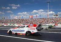 Jun. 2, 2013; Englishtown, NJ, USA: NHRA funny car driver Bob Tasca III (near lane) races alongside Jeff Arend during the Summer Nationals at Raceway Park. Mandatory Credit: Mark J. Rebilas-