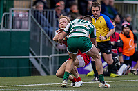 Will Homer of Jersey Reds is tackled by Peter Lydon of Ealing Trailfinders during the Championship Cup QF match between Ealing Trailfinders and Jersey Reds at Castle Bar, West Ealing, England  on 22 February 2020. Photo by David Horn.