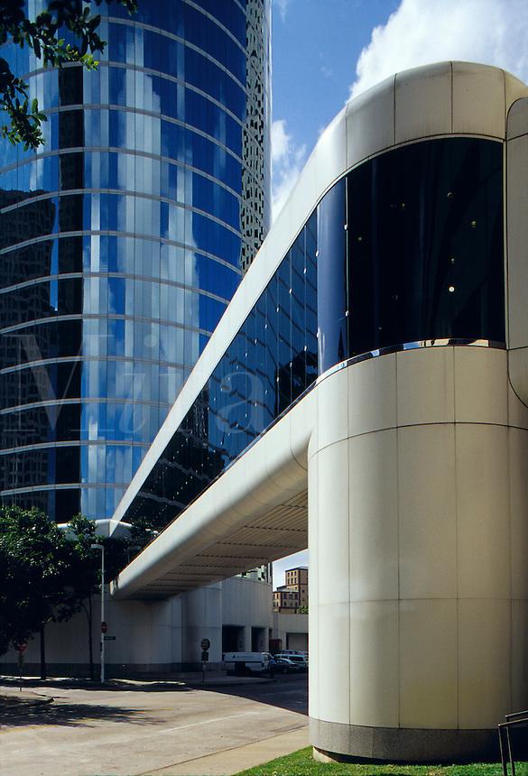 The Enron Building shows striking architecture. In foreground is bridge to garage. Houston, Texas