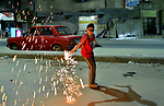 Egyptian and Sudanese children play with fireworks during the first day of Muslim holy month of Ramadan, in Cairo, Egypt, on April 24, 2020. Muslims around the world celebrate the holy month of Ramadan by praying during the night time and abstaining from eating, drinking, and sexual acts during the period between sunrise and sunset. Photo by Amr Sayed
