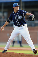Asheville Tourists pitcher Josh Slaats #33 delivers a pitch during  a  game  against the Charleston RiverDogs   at McCormick Field on August 4, 2011 in Asheville, North Carolina. Asheville won the game 5-4.   (Tony Farlow/Four Seam Images)