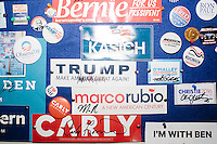 Buttons and stickers from the 2016 presidential campaign hang on a bulletin board in the visitor's center in the New Hampshire State House in Concord, New Hampshire. The bulletin board has campaign materials from campaigns dating back decades.