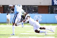CHAPEL HILL, NC - NOVEMBER 14: Ja'Sir Taylor #6 of Wake Forest tackles Dyami Brown #2 of North Carolina during a game between Wake Forest and North Carolina at Kenan Memorial Stadium on November 14, 2020 in Chapel Hill, North Carolina.