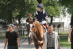 """Point of Entry with Jose Lezcano aboard win the $600,00 Grade I Man O' War Stakes for 3-year olds & up, going 1 3/8 mile on the Widner turf course at Belmont Park.  Trainer Claude """"Shug"""" McGaughey III.  Owner Phipps Stable."""