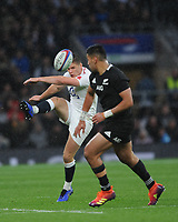 Owen Farrell (cc) of England chips ahead during the Quilter International match between England and New Zealand at Twickenham Stadium on Saturday 10th November 2018 (Photo by Rob Munro/Stewart Communications)