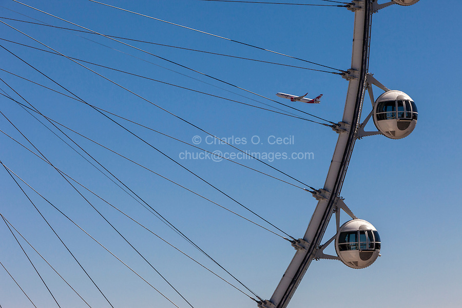 Las Vegas, Nevada.  High Roller, Airplane taking off in Background.  The High Roller is the world's tallest observation wheel as of 2015.