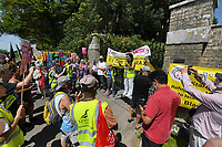BNPS.co.uk (01202) 558833.<br /> Pic: ZacharyCulpin/BNPS<br /> <br /> Pictured: Stand Up To Racism protest at the massive estate owned by Mr Drax in Winterborne Zelston in Dorset in July 2021<br /> <br /> Schoolchildren took part in an eight hour mock trial of a millionaire Tory MP over slavery 'charges' relating to his ancestors, it has been revealed.<br />  <br /> Richard Drax was put in the fictional dock charged with 'benefitting from the proceeds of slavery' due to his relatives' involvement in the slave trade.<br /> <br /> Forty pupils aged between 12 and 18 were involved in the case, taking on the roles of prosecution and defence lawyers while others were split into three juries.<br /> <br /> The event was organised by leading human rights lawyer Clive Stafford Smith who acted as the judge.<br /> <br /> It was the first 'Generation on Trial' event which Mr Stafford Smith's anti-injustice charity 3DCentre is staging.