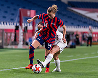 SAITAMA, JAPAN - JULY 24: Emily Sonnett #14 of the USWNT fights for the ball with Olivia Chance #11 of New Zealand during a game between New Zealand and USWNT at Saitama Stadium on July 24, 2021 in Saitama, Japan.