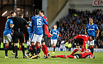 Kirk Broadfoot clutching his face on the pitch